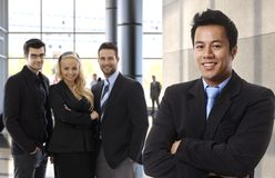 Successful asian businessman leading business team. Happy people at office lobby Royalty Free Stock Photos