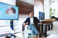 Successful asian men entrepreneur relaxing in restaurant during work break Royalty Free Stock Photo