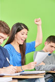 Successful asian student celebrates. Her test results in class Royalty Free Stock Photo