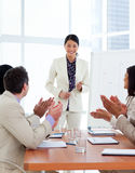 Successful asian woman giving a presentation. In a company stock photos