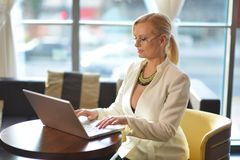 Successful and atractive middle aged businesswoman working Royalty Free Stock Photo
