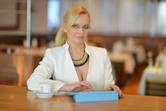 Successful and atractive middle aged woman working Royalty Free Stock Photos