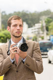 Successful attractive male photographer wearing Royalty Free Stock Photography