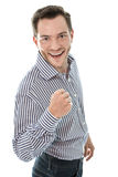 Successful attractive young business man holding fist up isolate Stock Image