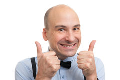 Successful bald man showing his thumbs up Stock Image