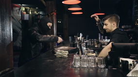 Successful bar robbery. The robber breaks into a bar and takes the money stock video footage
