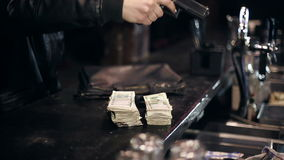 Successful bar robbery. The robber breaks into a bar and takes the money stock footage