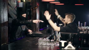 Successful bar robbery. The robber breaks into a bar and takes the money stock video