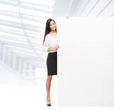 Successful and beautiful business woman with a banner Royalty Free Stock Photo