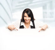 Successful and beautiful business woman with a banner Stock Photo