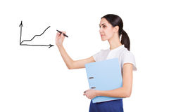 Successful beautiful business woman writing a graph Royalty Free Stock Image