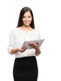 A successful and beautiful businesswoman with a tablet Stock Image