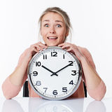 Successful beautiful young blond woman leaning on a clock Royalty Free Stock Photo