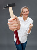Successful beautiful young woman expressing her home improvement power Royalty Free Stock Image