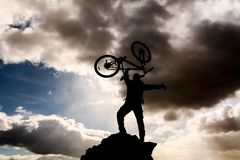 successful bike driver silhouette stock photography