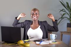 Successful black afro American businesswoman working at office smiling cheerful rising winner arms on victory sign Royalty Free Stock Photography