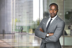 Successful black business man ceo downtown workspace proud confident arms crossed. Strong powerful handsome african american modern businessman pose looking Royalty Free Stock Photos