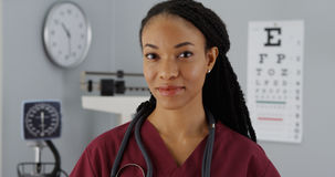 Successful Black woman doctor smiling at camera Stock Photo
