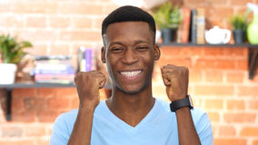 Successful Black Young Man Celebrating Success stock photography