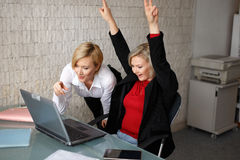 Successful blonde young managers in office. With laptop royalty free stock photos