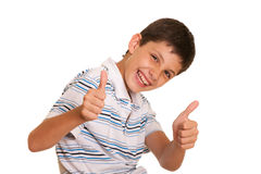 Successful boy holding his thumbs up Royalty Free Stock Photos