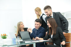 Successful busines team  in an modern office. Cheerful businessman discussing a new business project with the members of his team Stock Image