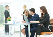 Successful busines team  in an modern office. Cheerful businessman discussing a new business project with the members of his team Royalty Free Stock Images