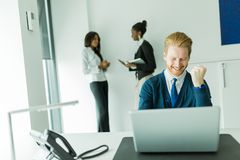 Successful businesman being happy for achieving his goals Stock Photo