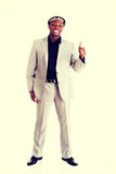 Successful businesman gesturing thumbs up. Stock Photo