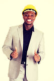 Successful businesman gesturing thumbs up. Stock Image