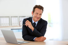 Successful businesman working at office. Businessman in office meeting business partner Royalty Free Stock Photos