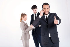 Successful business call. Successful and smiling African busines Stock Photo
