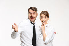 Successful business couple at the office looking at camera Royalty Free Stock Photos