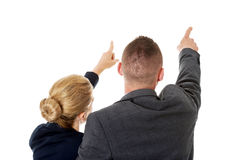 Successful business couple pointing away Stock Photography