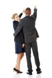 Successful business couple pointing away Stock Images