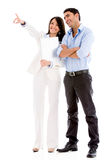 Business couple pointing away Stock Photos