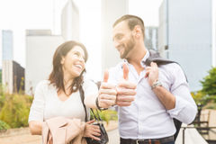 Successful business couple showing thumbs up Stock Photos