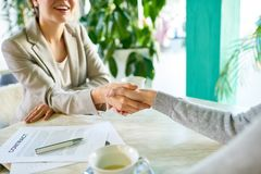 Successful Business Deal in Cafe stock photo