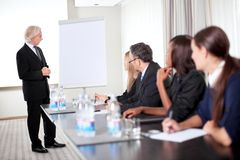 Successful business executive heading conference Stock Images