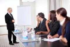 Successful business executive heading conference. Successful young male business executive heading a business conference stock images