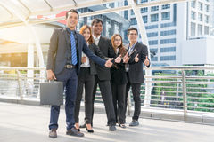 Successful business group with thumbs Stock Photography