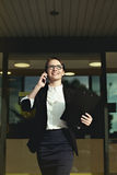 Successful business lady and professional lady walk around office. Royalty Free Stock Images