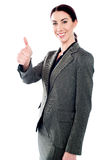 Successful business lady showing thumbs-up Stock Photos