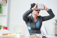 Successful business lady is watching modern gadget Royalty Free Stock Image