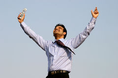 Successful  business man. Young successful business man happy getting a contract over mobile Royalty Free Stock Photo