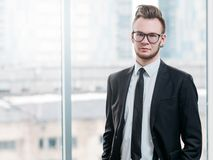 Successful business man ambitious attitude. Successful business man with ambitious attitude. Portrait of confident young leader standing in modern office royalty free stock photos