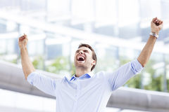 Successful business man with arms open Stock Photos