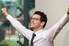 Successful Business Man With Arms Up At The Office Royalty Free Stock Photo