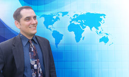Successful Business Man with Blue Vision. A middle aged business man is looking to the future with a blue background. He is looking at a map of the Earth and has stock photo