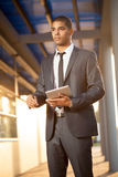 Successful business man with digital tablet outside Stock Images